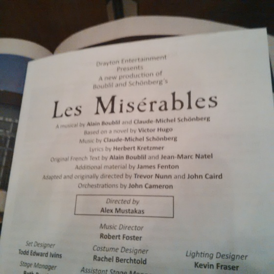 "Reading over the program...no kids touching us...noting the ""No Babes In Arms"" rule...loving the grown-up time."